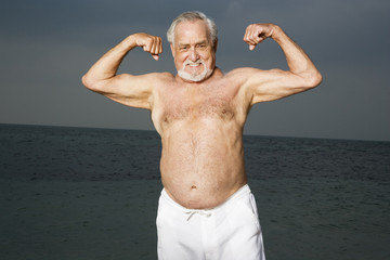 Portrait of a senior man flexing his biceps