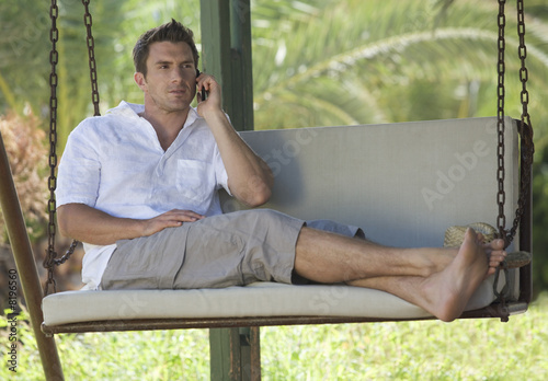 A man chatting on a mobile phone
