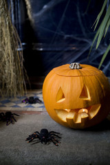 Atmospheric Hallowe'en scene - pumpkin, broomstick and spiders