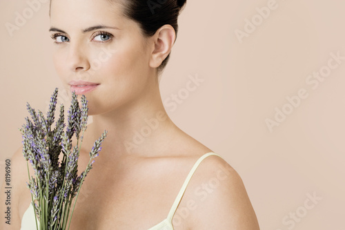 Woman holding a bunch of dried lavender