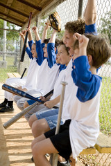 Side view little league baseball team cheering
