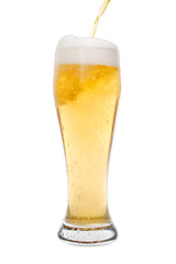 Pouring beer in a pilsner glass