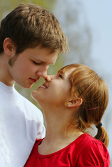 young man and woman  kissing