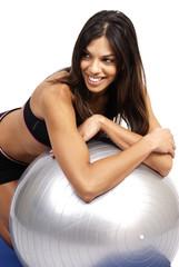 Beautiful brunette woman exercising