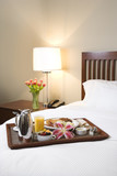 Breakfast tray on white bed. poster