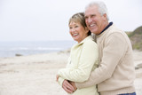 Couple at the beach embracing and smiling - Fine Art prints