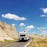 Camper on scenic road. poster