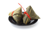 Two wrapped Chinese rice dumplings poster