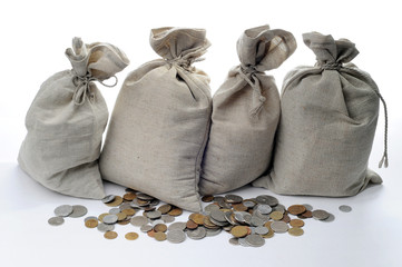 Money sacks and coins on a white background