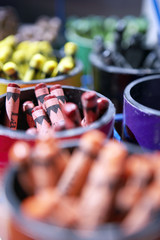 Pots of multi-coloured crayons in rows, close-up (still life, differential focus, full frame)