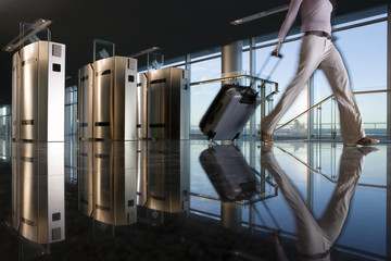Woman with luggage walking away from security barrier, surface level, reflection on floor