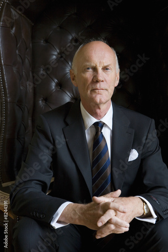 Senior man in armchair, portrait