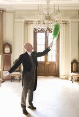 Butler dusting chandelier, side view