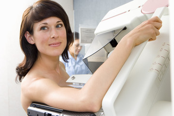 Topless woman having mammogram, close-up