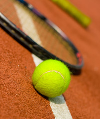 A tennis ball with rackets on the background.jpg