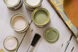 Small tins of paint on floor, close-up, overhead view (still life)