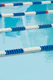 Lane separators in outdoor swimming pool poster