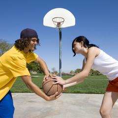 Couple plays basketball