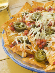 Platter of Nachos with Salsa, Jalapenos and Cheese