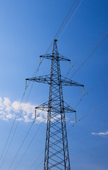Electrical tower on blue sky