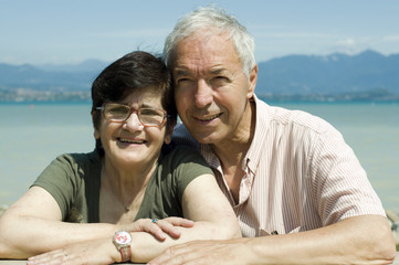 an elderly couple at the lake