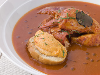 Bowl of Lobster Bisque with Rouille Croute and Sliced Truffle