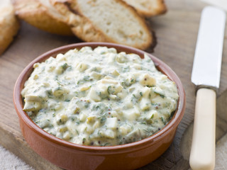Dish of Sauce Gribiche with Toasted Baguette