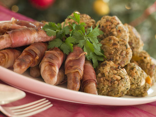 Plate of Susages in bacon and Chestnut Stuffing Balls