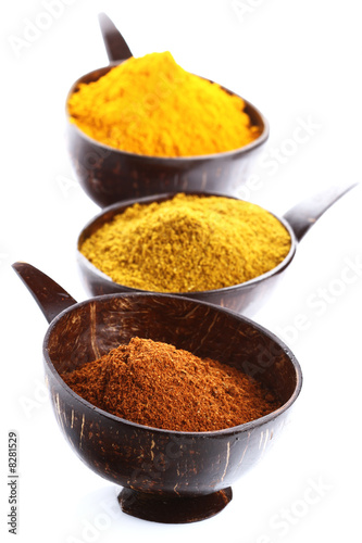 spices - pile of bright Madras Curry Powder and 2 bowls behind