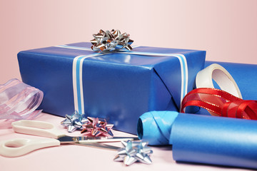 Gift with scissors, tape and ribbons