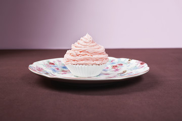 Pink cupcake on plate