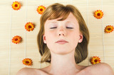 beautiful woman in spa with flowers is relaxing poster