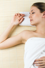 beautiful woman in spa with towels is relaxing
