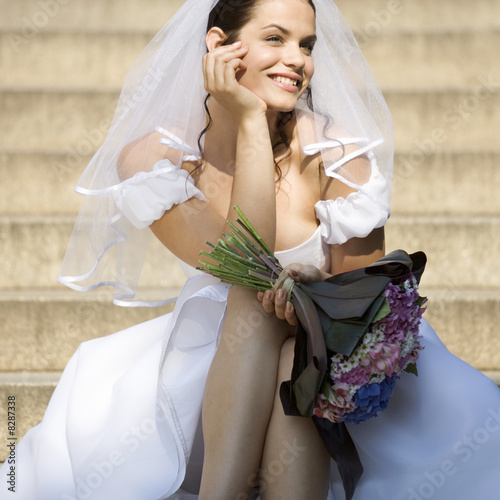 A bride sitting outside the church
