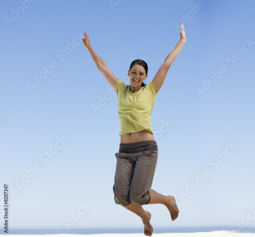 A young woman jumping