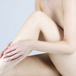 A female nude, sitting