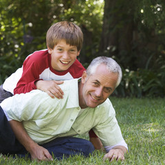 Father and son playing in a garden