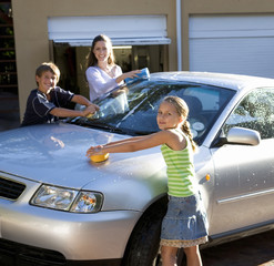 Mother and her children washing a car