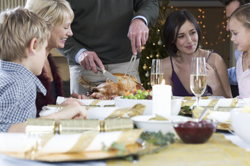 A family sitting down for Christmas dinner
