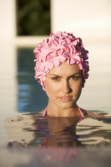 A woman in a swimming hat in a pool