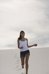 A young woman running in the desert