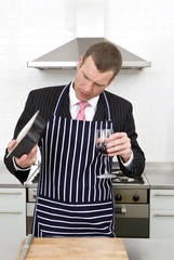 Businessman preparing a meal in the kitchen