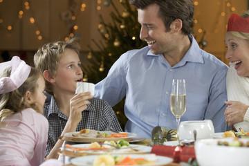 Family reading Christmas Cracker Jokes