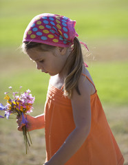 Young girl with a bunch of wildflowers
