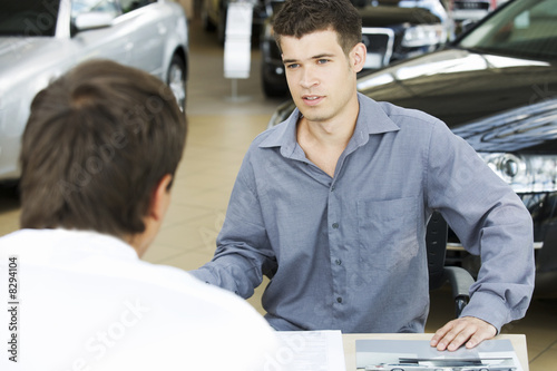 A young man buying a new car