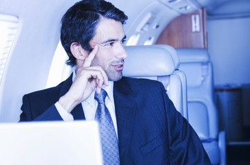 A businessman sitting on a plane