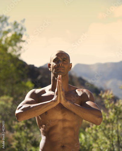 Bare chested young man practicing yoga