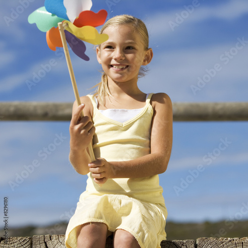 A young girl with a windmill