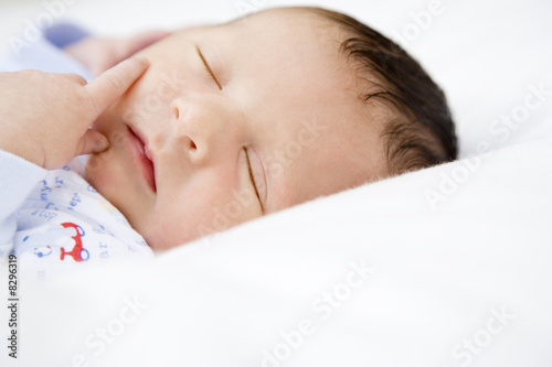 Portrait of a new born baby sleeping