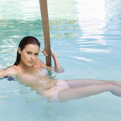 A young woman in a swimming pool